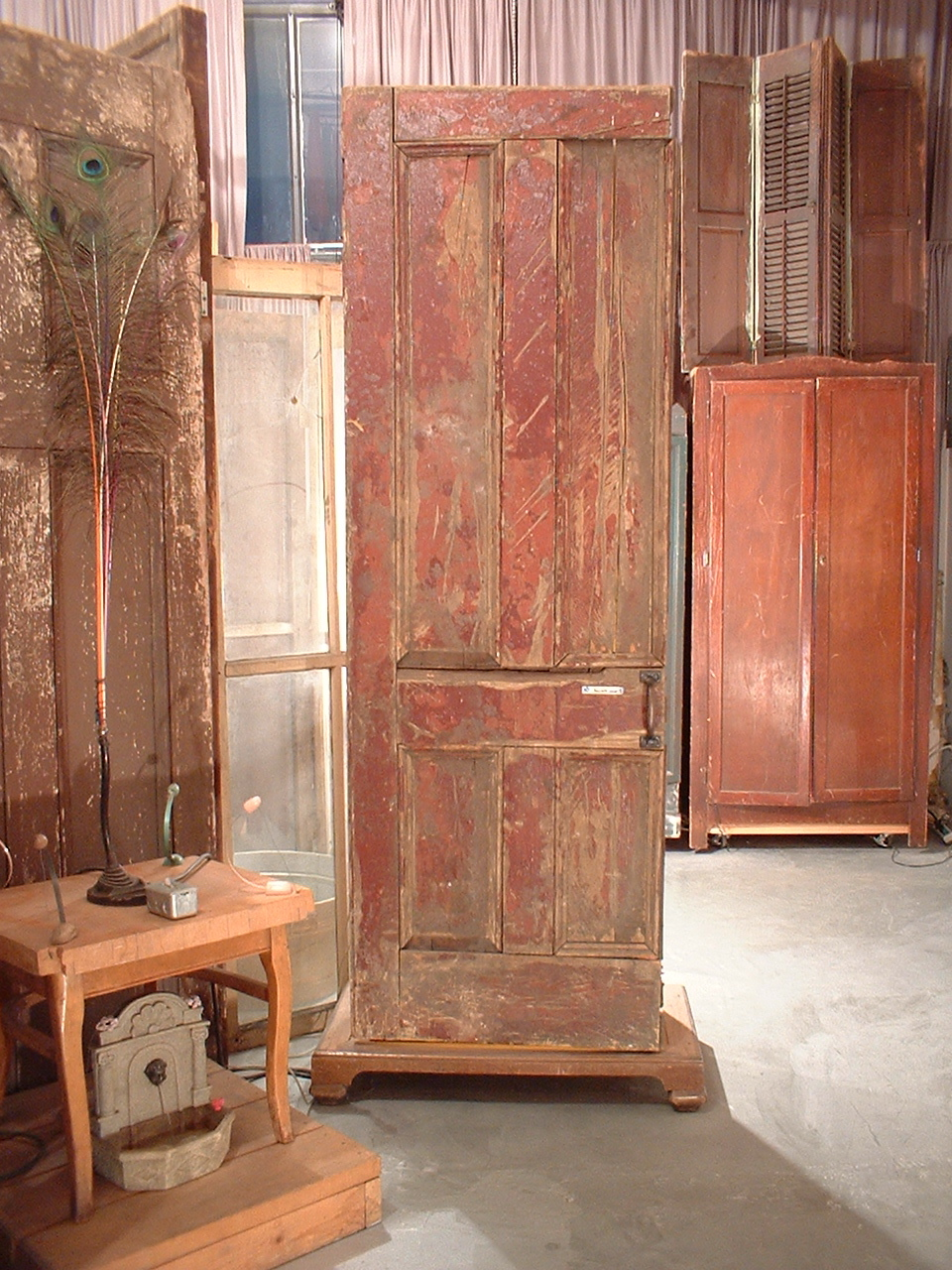 """[closed view] """"Smarty, Smarty, Smarty. Thought you had a party."""" 2001; doors, wood canvas, clay mercury vapor lamp, elect. components"""