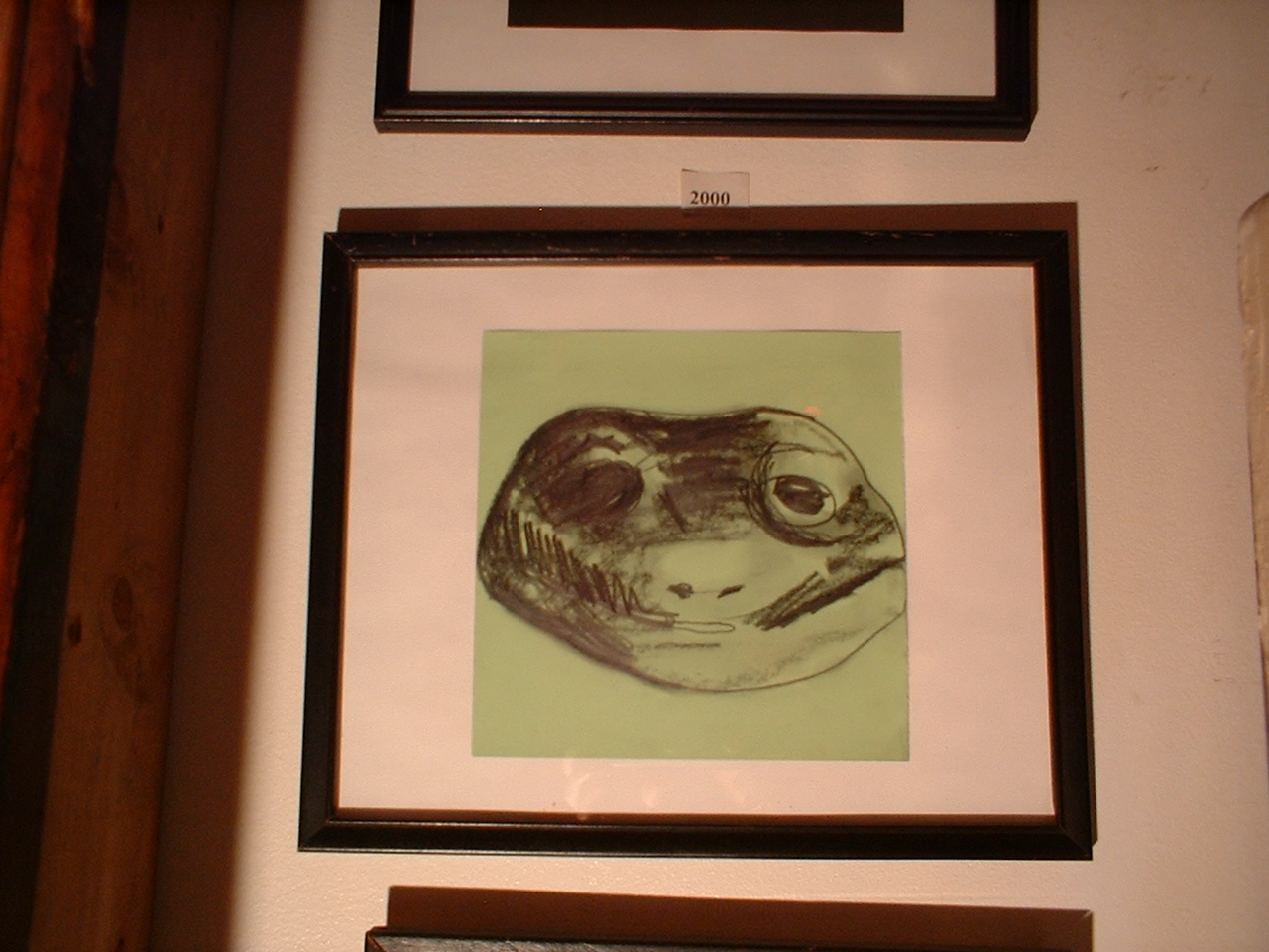 Frog mask. 2004; graphite on color-aid paper, mat board, frame w/ glass