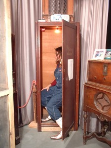 A small wardrobe now converted to a listening booth. 2000; wooden chamber with stereo devise, light, toy, electrical components, and a selection of audio works by Paula Lalala.