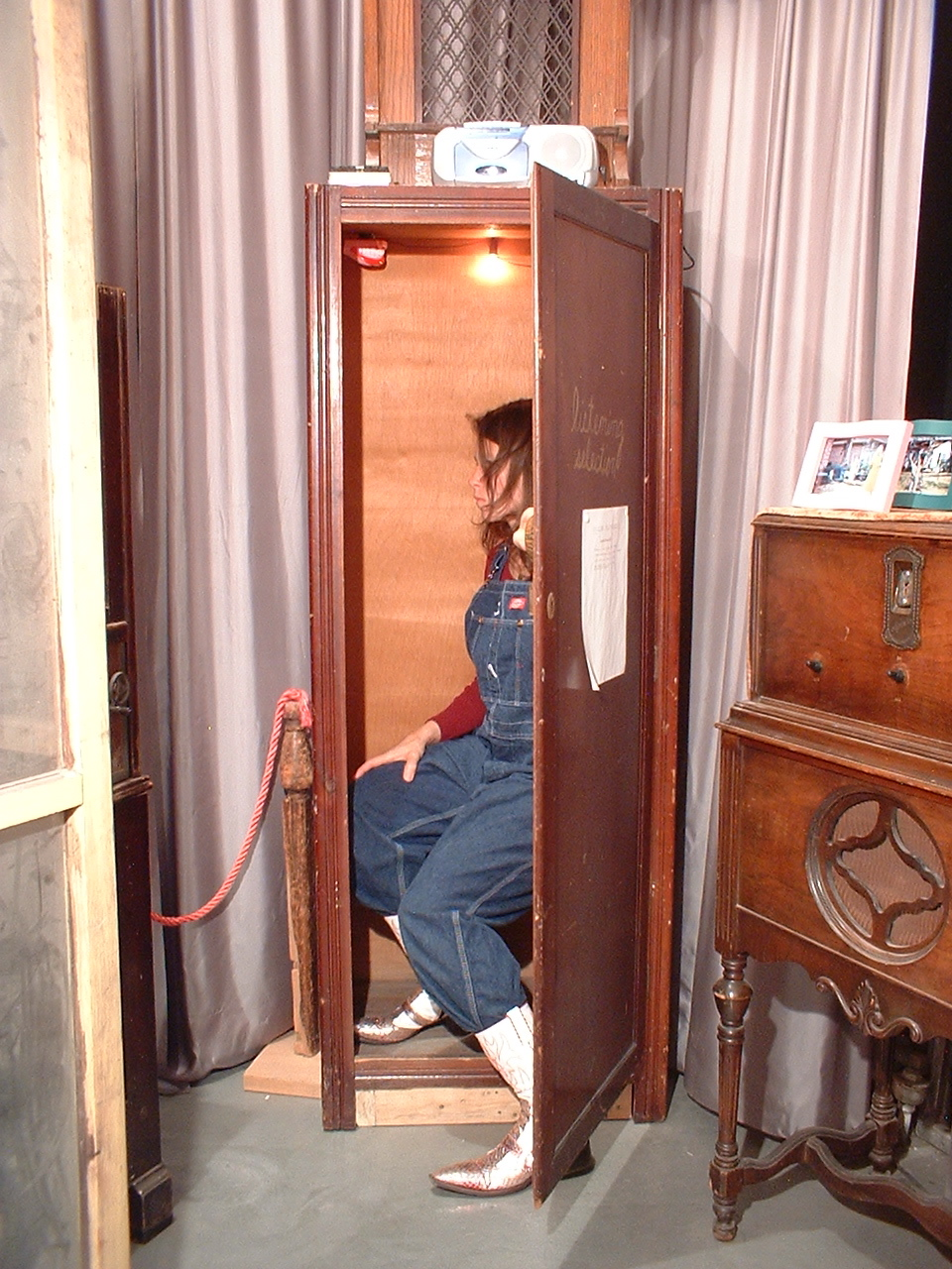 A small wardrobe now converted to a listening booth. 2000; wooden chamber with stereo device, light, toy, electrical components, and a selection of audio works by Paula Lalala.