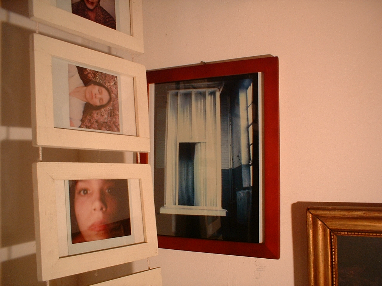 (including:) [detail] Thread of time, polaroid self portraits ages 21-33, some burned others given away. 2001; photos, string, frames. Artifact from Fut #3. 1989; color macine print, wooden frame.